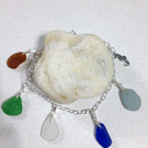 Sea glass charms on a sterling silver bracel with sterling silver seahorse charm