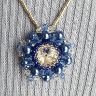 Blue beaded pendant on a silver beaded chain