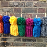 Chunky handknitted children, baby beanie hat in vibrant colours with huge pompom