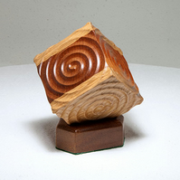 Ornamental Mahogany and Ash Spiral Cube with Stand