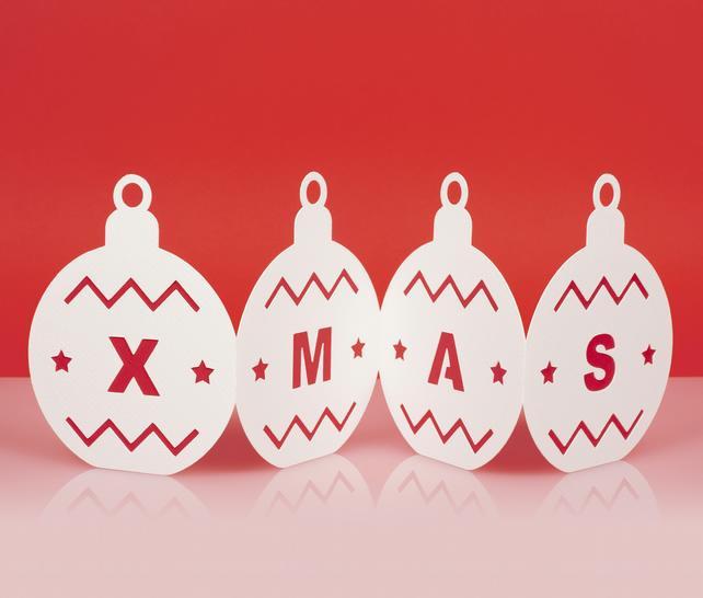 Luxury fold out bauble Christmas card with cut out pattern and 'XMAS' in red