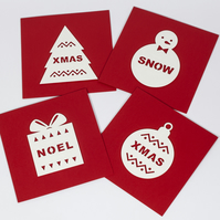 Pack of 4 stylish handmade Christmas cards with cut out festive illustrations