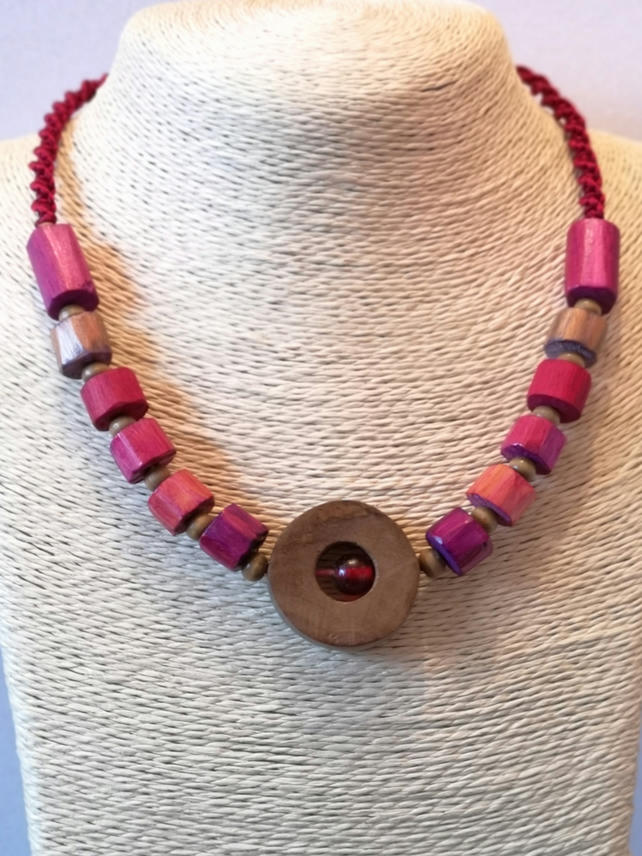 Hand cut wood purple, red, violet and brown necklace with braided satin finish