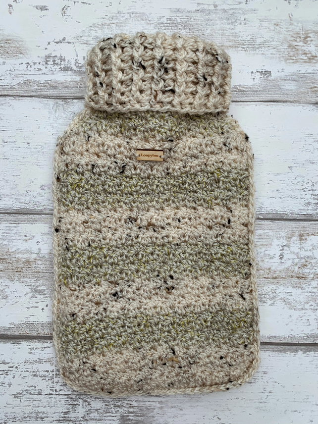 A hot water bottle and handmade crochet cover