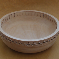 Lime wood bowl with twine decoration.