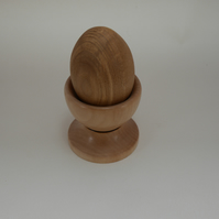 Hand turned wooden egg in an egg cup