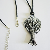 A beautiful Hand sculpted and painted natural silver metallic color tree pendant