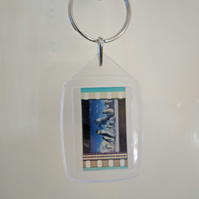Happy Feet film cell keyring made with a real film cell