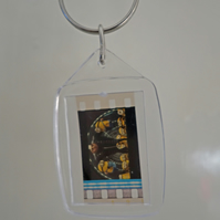 A Despicable Me Gru with Minions authentic film cell made into a keyring