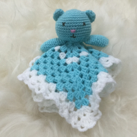 Crocheted teddy comforter blanket. Amigurumi teddy with granny squares blanket