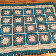 Granny squares pram or cot blanket hand crocheted with a pompom edging