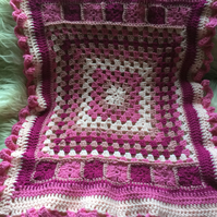 Beautiful pinks crocheted pram blanket. Ideal and unique gift