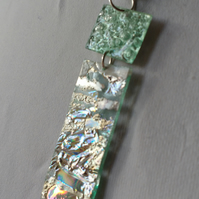 Two piece pendant. Silver and pale metallic green