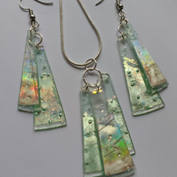 Matched set of earrings and a pendant. Silver and reflective green.