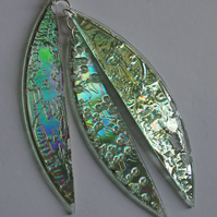 Metallic green-glass like three piece pendant.