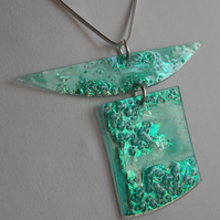 Two piece pendant. Dark turquoise with metallic highlights