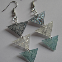 Reflective three piece drop earrings.