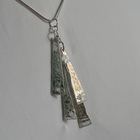 Sea green silvery four piece pendant.