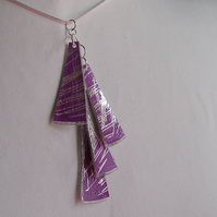 Four piece lilac and silver pendant.