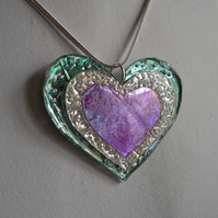 Colourful reflective heart pendant.
