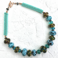 Turquoise and burnt lime lampwork necklace