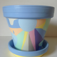 Funky flower pot and saucer in a rainbow of colours.