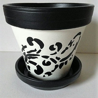 Black and white, hand painted flower pot and saucer.