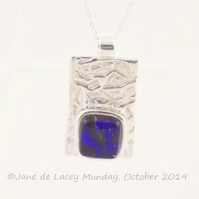Fine Silver Pendant with Purple Glass Cabachon