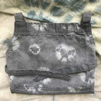 Grey tie-dyed children's apron using logwood, madder and iron (Age 2-4)