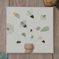 Cornish seaglass flowers in a seawashed pottery pot picture