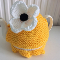 Knitted Tea Cosy with a Daisy fits a 4 to 6 cup pot