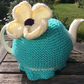 Knitted Tea Cosy in sea green Aqua with a Daisy fits a 4 to 6 cup pot