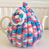 Daisy Tea Cosy in pink, turquoise and white tweed yarn fits to a 6 cup pot
