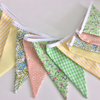 Floral bunting in citrus pastels with 12 flags