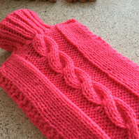 Knitted Hot Water Bottle Cover in bright pink, warm toes all year