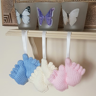 Nursery decorations, hand-knitted feet, pram charms