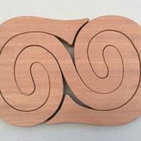 Large Curly Wurly Trivet in either Sapele or Tulipwood