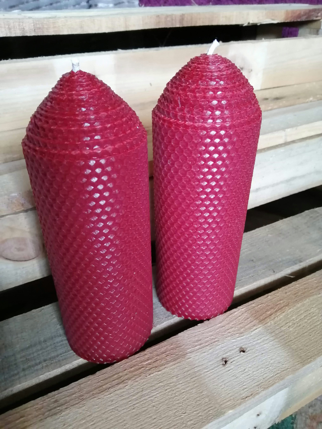 A pair of Dark Red rolled beeswax candles 70mm diameter x 195mm high