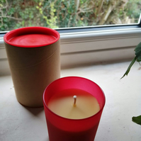 Beeswax candle in red glass handmade in Wales using organic beeswax