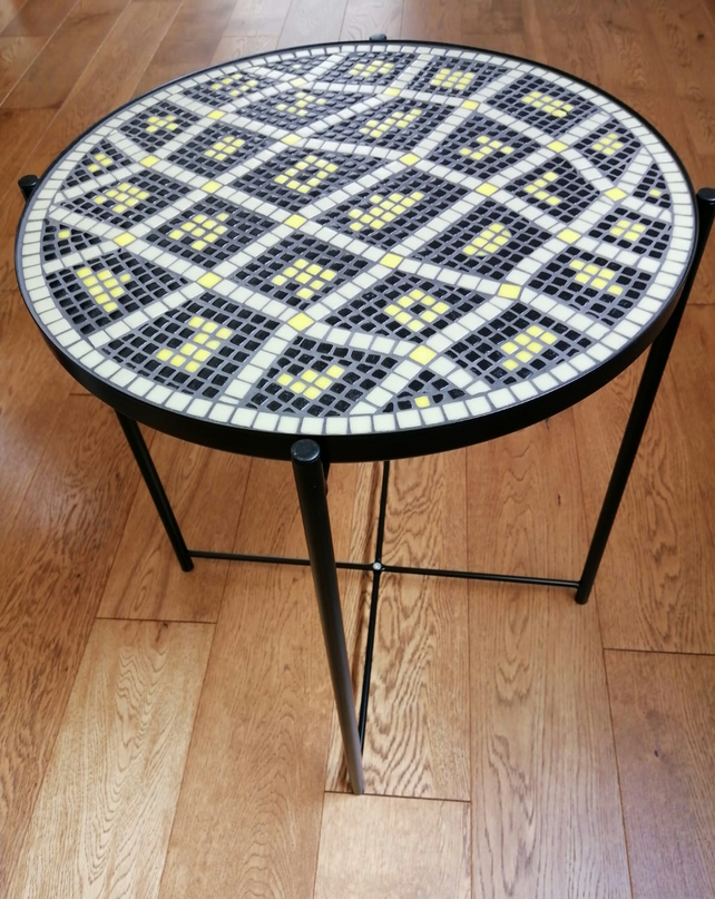 Attractive black table mosaiced with olive, black and yellow recycled glass tile