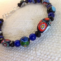 Elegant blue bead bracelet of vintage millefiori and French jet beads