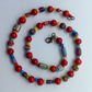 Bright bead necklace with red glass beads, Nepalese chevron beads and others