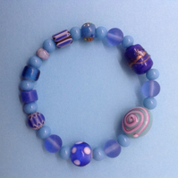 stretchy blue and turquoise bracelet with unusual bead collection 6.5""