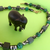 Tribal unisex bead necklace in grey, green and black.