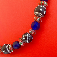 Beaded necklacklace with red patterned beads from Nepal and clay beads from Mali