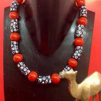 Black patterned African glass bead necklace with chunky round red beads