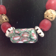 Cord necklace with large beads from Nepal and West Africa