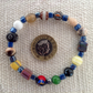 Bead collectors bracelet with blue lustre beads