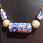 Chunky beaded necklace with brass beads from Africa and blue ones from Nepal