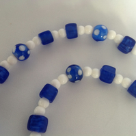 Beaded necklace with blue and white beads